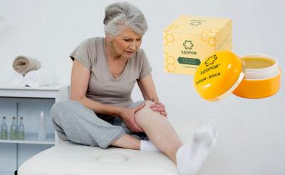 нанесение крема на колено